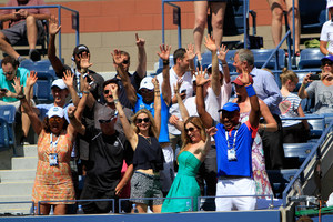 Friends and family celebrate Bob and Mike Bryan's victory in the Men's Doubles Championship at the 2014 US Open.