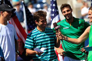 Marcel Granollers and Marc Lopez speak with Mary Joe Fernandez during the trophy ceremony for the Men's Doubles Championship at the 2014 US Open.