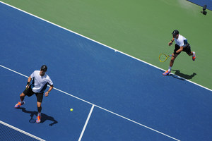 Bob and Mike Bryan take on Marcel Granollers and Marc Lopez in the Men's Doubles Championship in Arthur Ashe Stadium.