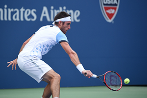 September 1, 2015 - Leonardo Mayer in action against Roger Federer in a men's singles first round match during the 2015 US Open at the USTA Billie Jean King National Tennis Center in Flushing, NY. (USTA/Andrew Ong)