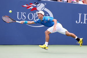 August 31, 2015 - Kei Nishikori in action against Benoit Paire (not pictured) in a Men's Singles - Round 1 match during the 2015 US Open at the USTA Billie Jean King National Tennis Center in Flushing, NY. (USTA/Ned Dishman)