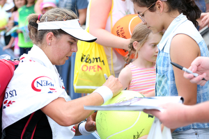 August 31, 2015 - Anna Tatishvili signs autographs after a women's singles first round match against Karolina Pliskova (not pictured) during the 2015 US Open at the USTA Billie Jean King National Tennis Center in Flushing, NY. (USTA/Ned Dishman)