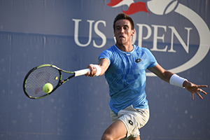 September 1, 2015 - Damir Dzumhur in action in a men's singles first round match against Bernard Tomic during the 2015 US Open at the USTA Billie Jean King National Tennis Center in Flushing, NY. (USTA/Steven Ryan)