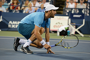 September 2, 2015 - Steve Johnson in action in a men's doubles first round match during the 2015 US Open at the USTA Billie Jean King National Tennis Center in Flushing, NY. (USTA/Garrett Ellwood)
