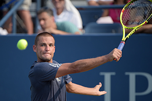 September 3, 2015 - Mikhail Youzhny in action in a men's singles second round match against John Isner during the 2015 US Open at the USTA Billie Jean King National Tennis Center in Flushing, NY. (USTA/Pete Staples)