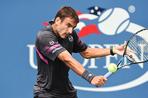 September 4, 2015 - Tommy Robredo in action in a men's singles third-round match against Benoit Paire during the 2015 US Open at the USTA Billie Jean King National Tennis Center in Flushing, NY. (USTA/Garrett Ellwood)