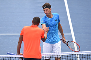September 4, 2015 - Sergiy Stakhovsky shakes hands after a men's singles third-round match against Jo-Wilfried Tsonga during the 2015 US Open at the USTA Billie Jean King National Tennis Center in Flushing, NY. (USTA/Garrett Ellwood)