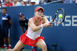 September 4, 2015 - Eugenie Bouchard in action against Dominika Cibulkova (not pictured) in a women's singles third-round match during the 2015 US Open at the USTA Billie Jean King National Tennis Center in Flushing, NY. (USTA/Ned Dishman)