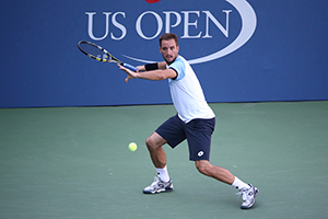 September 5, 2015 - Viktor Troicki in action in a men's singles third-round match against Donald Young during the 2015 US Open at the USTA Billie Jean King National Tennis Center in Flushing, NY. (USTA/Ned Dishman)