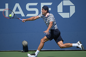 September 5, 2015 - Guillermo Garcia-Lopez in action in a men's singles third-round match against Tomas Berdych during the 2015 US Open at the USTA Billie Jean King National Tennis Center in Flushing, NY. (USTA/Pete Staples)