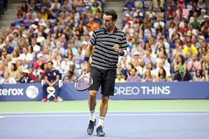 September 6, 2015 - Roberto Bautista Agut reacts against Novak Djokovic (not pictured) in a men's singles fourth-round match during the 2015 US Open at the USTA Billie Jean King National Tennis Center in Flushing, NY. (USTA/Ned Dishman)