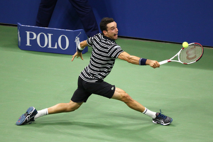 September 6, 2015 - Roberto Bautista Agut in action against Novak Djokovic (not pictured) in a men's singles fourth-round match during the 2015 US Open at the USTA Billie Jean King National Tennis Center in Flushing, NY. (USTA/Ned Dishman)