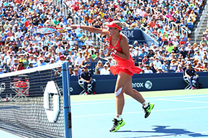September 7, 2015 - Sabine Lisicki in action in a women's singles fourth-round match against Simona Halep during the 2015 US Open at the USTA Billie Jean King National Tennis Center in Flushing, NY. (USTA/Ned Dishman)