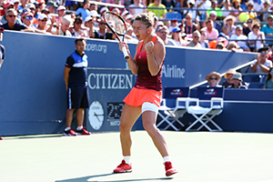 September 7, 2015 - Simona Halep celebrates her win in a women's singles fourth-round match against Sabine Lisicki during the 2015 US Open at the USTA Billie Jean King National Tennis Center in Flushing, NY. (USTA/Ned Dishman)