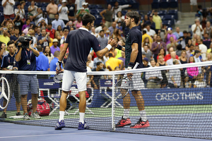 September 8, 2015 - Novak Djokovic shakes hands with Feliciano Lopez after a men's singles quarterfinal match during the 2015 US Open at the USTA Billie Jean King National Tennis Center in Flushing, NY. (USTA/Michael LeBrecht)