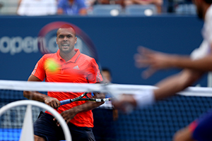 September 8, 2015 - Jo-Wilfried Tsonga framed by the racquet of Marin Cilic in action in a men's singles quarterfinal match during the 2015 US Open at the USTA Billie Jean King National Tennis Center in Flushing, NY. (USTA/Michael LeBrecht)
