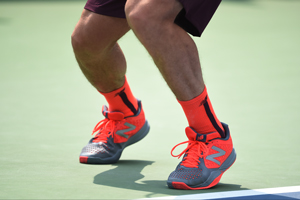 September 2, 2015 - Milos Raonic wearing bright orange shows in action against Fernando Verdasco in a men's singles second round match during the 2015 US Open at the USTA Billie Jean King National Tennis Center in Flushing, NY. (USTA/Andrew Ong)